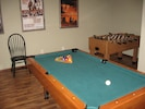 Challenge the grandkids to a game of pool or foosball!