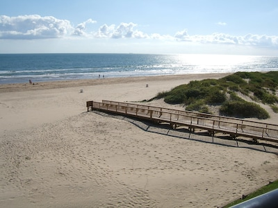 To get to the beach - go down to 1st floor, exit building & take this beach walk