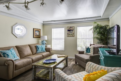 This living room is part of the open concept living space.