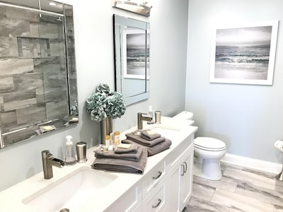 Ensuite bathroom with double vanity and large walk-in shower
