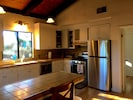 Fully stocked and upgraded kitchen with new stainless steel gas stove, etc.