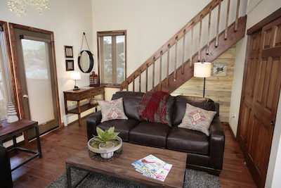 Living room with stairs to loft
