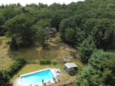 Aerial view of cottage & our shared pool on 10 acres mountain top property . 🏡
