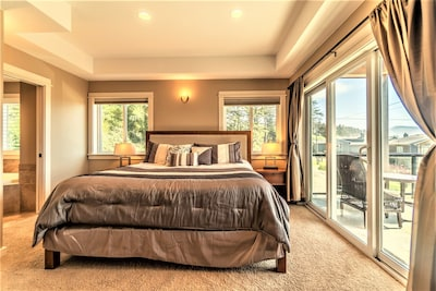 Master Suite #1 with full bath, large Jacuzzi, TV and private deck