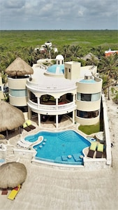 Aerial view of Villa Escapar from the white sand beach behind the villa