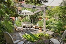 Summer - Picture captures the many tranquil sitting areas from behind Koi Pond.