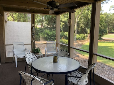 ENJOY A COOL DRINK ON THE PORCH, AND WATCH THE GOLFERS TEE OFF.