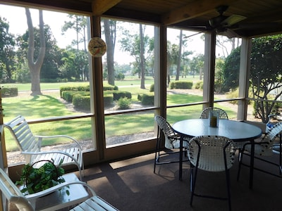 SCREENED PORCH WITH CEILING FAN OVERLOOKING THE 9TH TEE HARBOUR TOWN GOLF COURSE