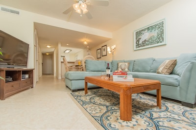 "Living Room features ocean and pool views with large comfortable sofa, 47"" HD TV"