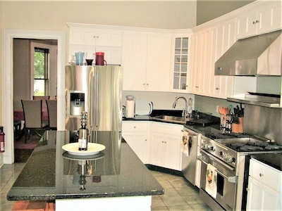 Gourmet kitchen with commercial grade oven/stove - stainless steel appliances