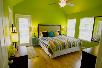 """Bedroom One features a comfy king bed, 55"""" TV / Smart Blu-ray, & private bath."""