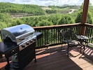 Each side has it's own propane grill with a great view from the deck of Branson!