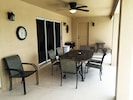 Large lanai for outdoor entertaining;. Seating for 8.  Access to second bathroom