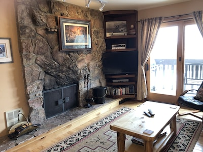 Wood fireplace, HD Smart TV, Bluetooth stereo and DVD player.