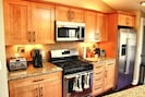 New chef's kitchen w/ high-end granite counters, maple cabinets & SS appliances