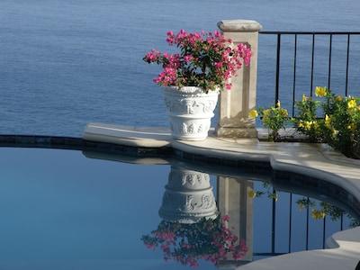 Pool deck with infinite ocean views.