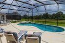 Pool area overlooking lake and conservation area