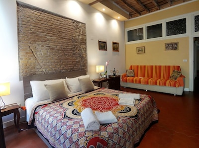 """First Bedroom. Original ceiling in wood and wall in red """"cotto"""" bricks 1700"""