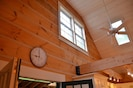 Vaulted ceilings with upper window, skylights, bring in southern-exposed light.