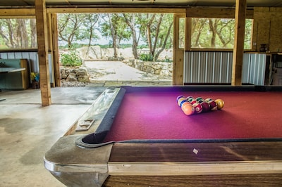 Party barn pool table, opens out to a huge view of the Texas hill country.