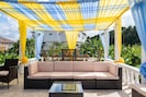 Relax beneath the canopy, while  your bartender serves your favorite cocktails