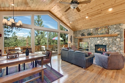 LIVING ROOM ROOM WITH PINE CEILINGS, HICKORY WOOD FLOORING , LARGE WINDOWS.