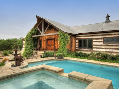 The exterior of The Lodge over looking the pool and hot tub