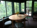 Screened porch is great for dining.