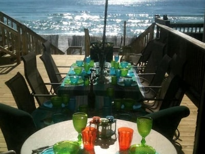 Dining to the sound of the gulf on private beach deck. 7 steps down to beach.