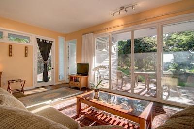 Comfy sofa with a garden view.