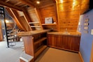 Wet bar area with tv