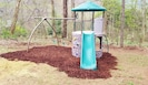 Playset - rock climbing wall, slide, swings, trapeze bar,  tower clubhouse