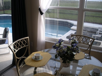 Breakfast knook with view of pool from kitchen.