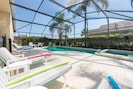 Pool deck and padded sun loungers