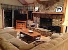 Living room has double sliding doors that open to upper deck
