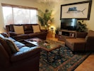 Enjoy gathering in the large comfortable living room.