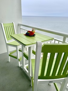 Oceanfront dining for 4 on the balcony - watch the dolphins from your chair!
