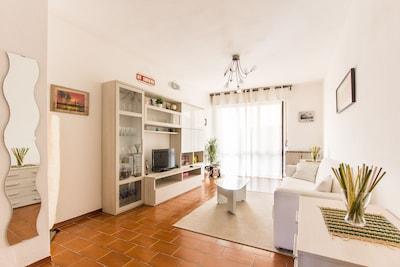 Nuovo appartamento al piano terra con ampio giardino e posto auto privato
