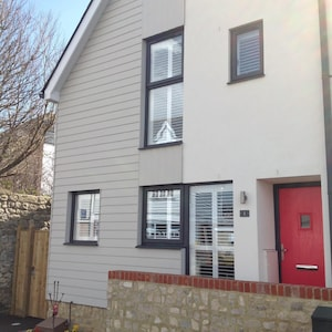 Sunny house with shutters throughout