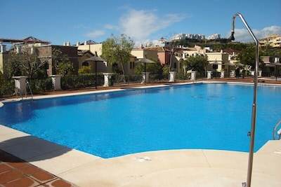 Main swimming pool directly behind apartment