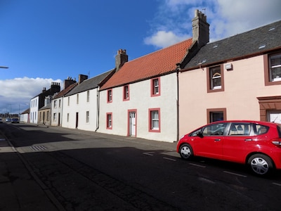 My cottage is the white one with red windows