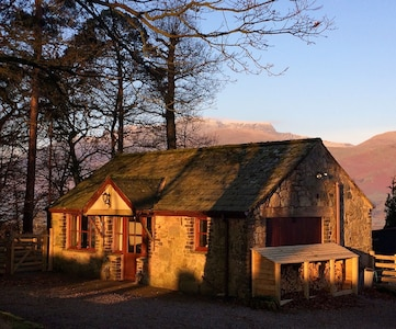 Erika's Cottage basking in the morning sun with Blencathra in the background