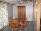 Dining area  leading to outdoor deck. Cabinet contains paper products