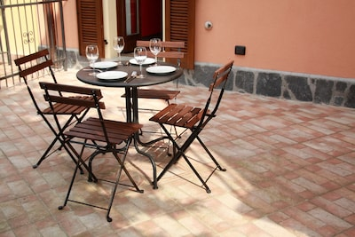 Terrace of our holiday apartment with flat behind