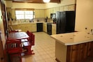 Kitchen with breakfast nook table. (There is also a dining table that seats 12)