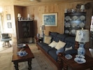 Open Great Room furnished with family treasures.