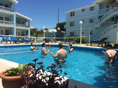 Wedding attendees having fun and playing water volleyball!