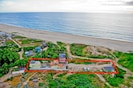 This property sets on a pristine 3 mile white sand beach!