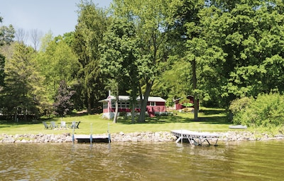 Flat yard on the lake side. 1/2 acre lot for privacy and empty lot on north side