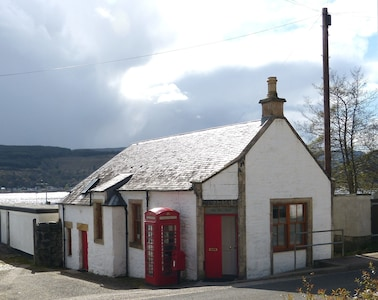 Post Office House, with Holy Loch behind.